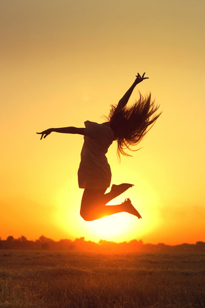naughty woman: Happy girl in the rays of the setting sun Stock Photo