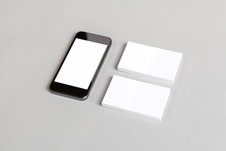 business cards: Photo of business cards and smartphone. Mock-up for branding identity. For graphic designers presentations and portfolios