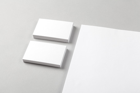white sheet: Photo of business card & part of the Letterhead. Mock-up for branding identity. For graphic designers presentations and portfolios