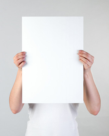 boards: Woman holding a blank poster