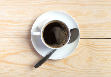 mote: Photo. Cup of coffee on the table from untreated wood Stock Photo