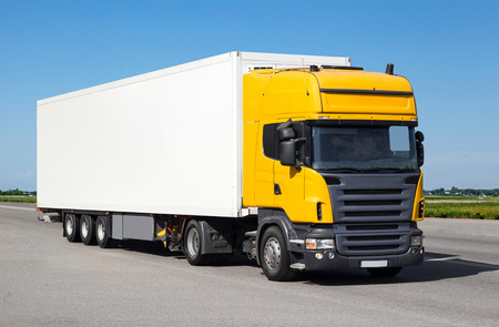 autotruck: White track with yellow cabin. Cargo transportation Stock Photo