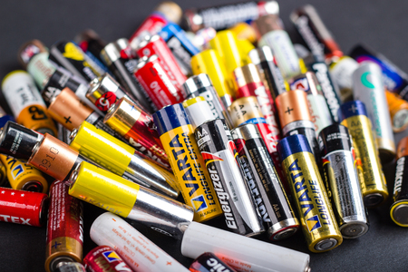Bunch of AA batteries isolated in dark grey background, Kazakhstan, Almaty, April, 5, 2017.