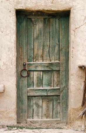 wood door: Photo of Old wood door. Close up green texture weathered surface door. Stock Photo