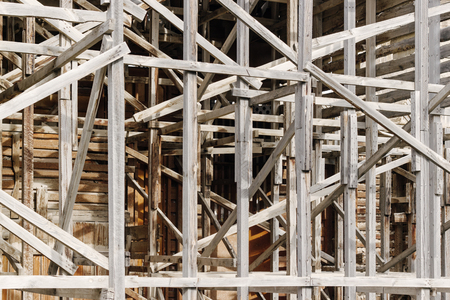 scaffolds: Old wooden scaffolding. Spatial structure. Dirty damaged weathered texture. Stock Photo