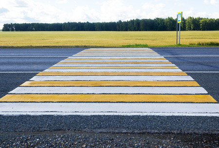 Pedestrian crossing on a country road Stock Photo
