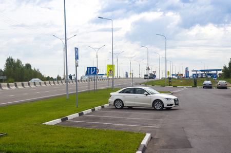 Novosibirsk, Russia - August 09, 2017: Audi A3 at the gas station paring on the background of the road infrastructure