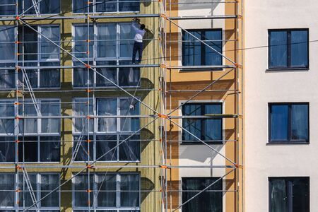 Construction of residential building, decoration facade. Plastering work