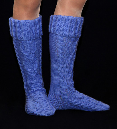 gaiters: Blue gaiters from wool on female feet Stock Photo