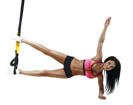 Beautiful fitness woman do trx side plank series with trx suspensions. Workout. Isolated on white background. Stock Photo