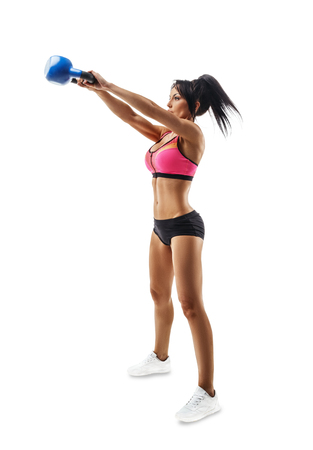 Fitness woman do kettlebell swing and kettlebell snatch. Crossfit training. Isolated on white background. Stockfoto