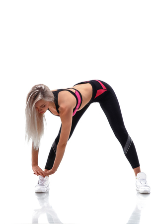 Fitness woman doing stretching workout, studio isolated on white background