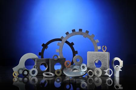 Set of many types of lock washers on blue background