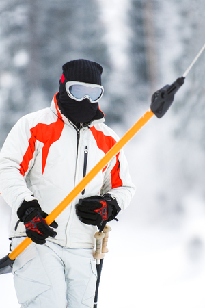 Alpine skier using a surface lift on the slope