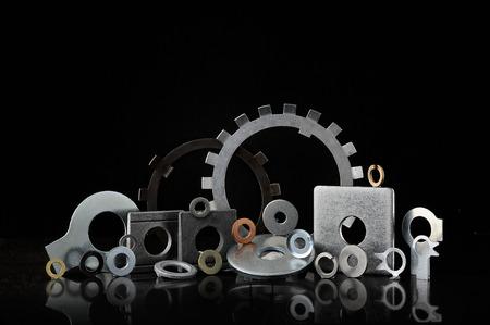 Set of many types of lock washers on black background