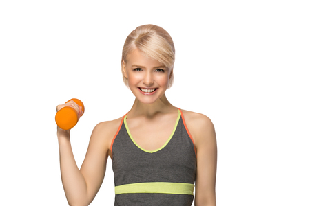 Happy smiling slim woman with dumbbell isolated on white background 版權商用圖片