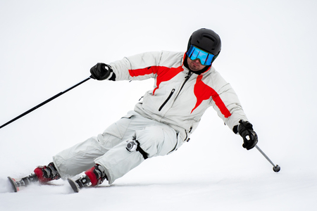 Professional alpine slalom skier skiing on prepared piste on fresh snow in mountains , action camera on leg Stock fotó