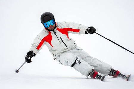 Professional alpine slalom skier skiing on prepared slope on fresh snow in mountains , action camera on leg