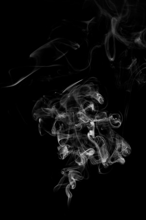 Movement of white smoke isolated on black background. Фото со стока