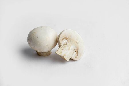 fresh champignon mushrooms on a white background Banco de Imagens