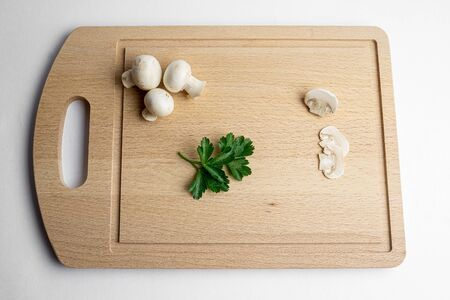 Fresh champignon mushrooms on wood