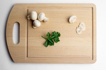 Fresh champignon mushrooms on wood