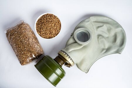 gas mask and pack of buckwheat on a white background