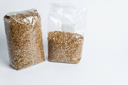 buckwheat in the plastic packet under the white background
