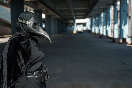 plague doctor in an empty city on an empty marina