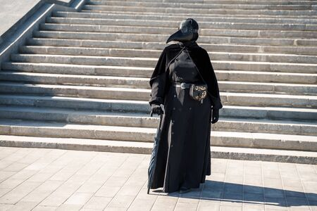 plague doctor in front of the stairs to the top Banco de Imagens