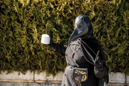 plague doctor holds toilet paper on a background of plants