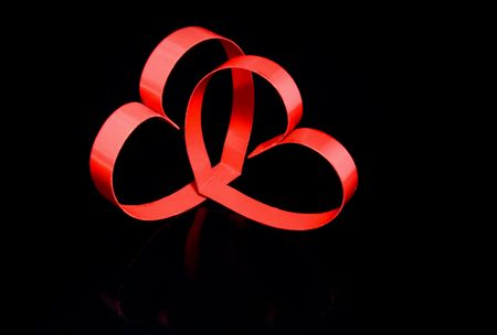 finesse: Two hearts with center spot light, on black  background