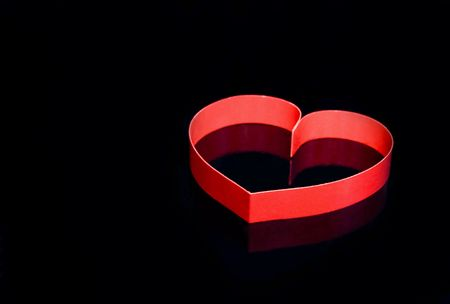 finesse: Single heart, on black background. Stock Photo
