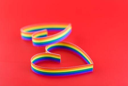 bandera gay: Dos corazones, pintura de colores bandera gay.