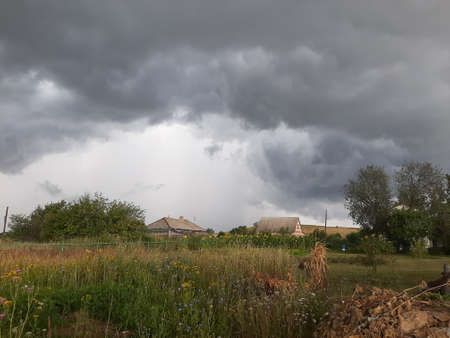 Farmland scenery storm. Wait for hurricane in the countryside