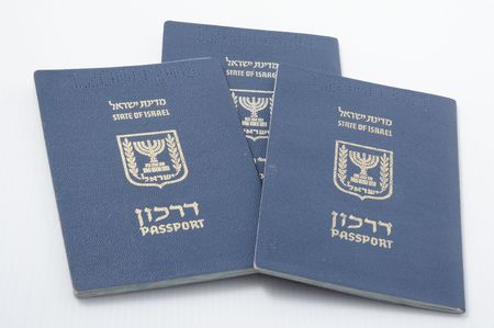 Three Israeli passport isolated on a white background. photo