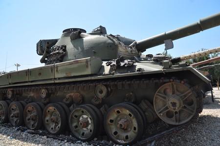 Old tank against the blue sky . Israel, Latrun. photo
