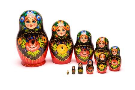 matryoshkas: beautiful nesting doll handmade on a white background
