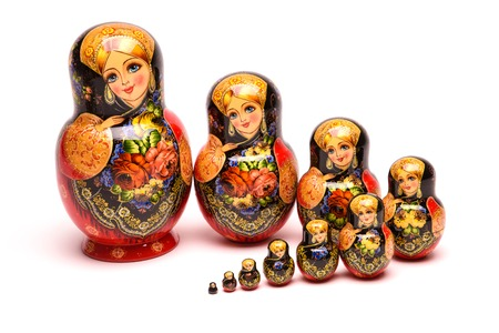 russian nested dolls: beautiful nesting doll handmade on a white background