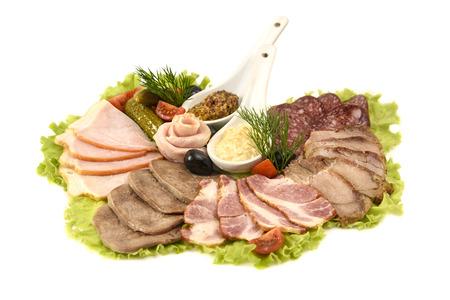 jamones: Selección de los jamones y salami en un fondo blanco