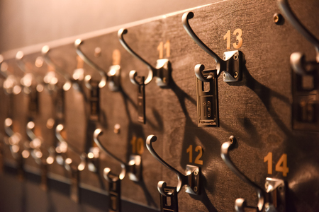hangers with numbers in a dark wood Stock Photo