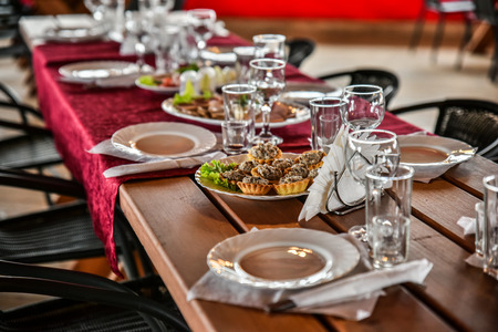 sumptuous: sumptuous Banquet in a wooden gazebo is beautifully decorated in a traditional style. Stock Photo