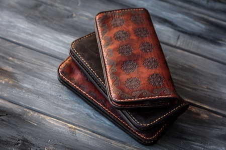 Group old Wallet of Leather skin on wooden background. Stock Photo