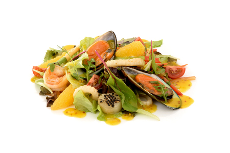 japanese cookery: salad with mussels, shrimp, squid and oranges isolate