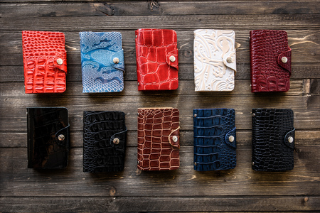 Group colorful Wallet of Leather skin on wooden background