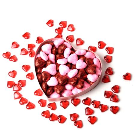 sexualidad: corazón brillante con puntos brillantes en el cuadro en forma de sobre fondo blanco