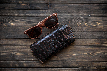 crystalline lens: fashionable glasses with a leather holster on wooden background close-up Stock Photo