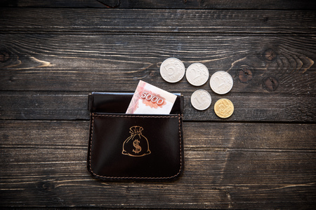 bankcard: Stylish leather wallet with money and box on wooden background