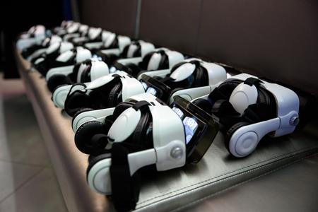 many virtual reality VR helmet on dark background