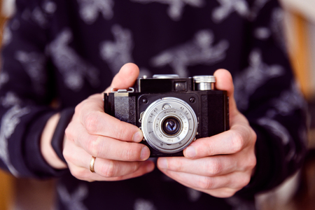 Hands taking photo with retro camera close-up Stock Photo
